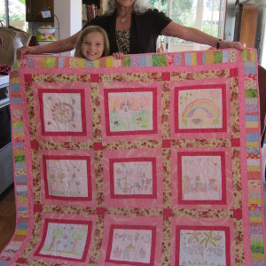 Jannae with the Art Quilt that Grandma Shirley made for her (she drew the pictures when she was 5 and 6 years old.)