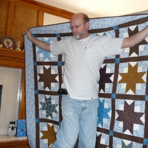 Fred and his quilt (wearing one of his POCKET Ts)