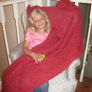 Red knitted afghan shown here with Grandangel Shirley Anne Johnson